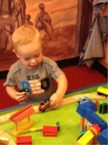 This is my son playing with the trains at the Children's Museum.  He could spend hours there!