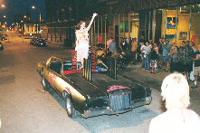 """We Ain't Stupid""  art demolition derby Art Car,  Ms. Sandi Corder wearing Deborah Borel dress,  2001,  18th Street Fashion Show."
