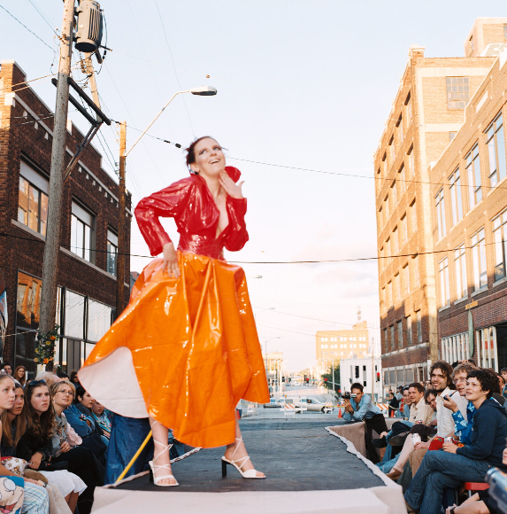 Ms. Megan Goddard, in vinyl couture by Bill Drummond, at the 18 street Fashion Show - produced by Isabel's Boutique