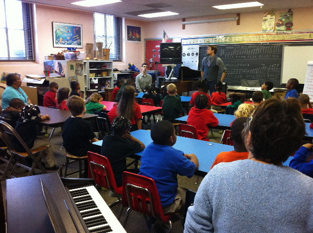 Alek Shrader, tenor, sang for students at Gordon Parks Elementary School while he was in KC for a recital on the Harriman-Jewell Series.