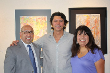 Mattie Rhodes Center President/CEO John Fierro, and Cultural Arts Director Jenny Mendez visit with Lou Diamond Phillips.