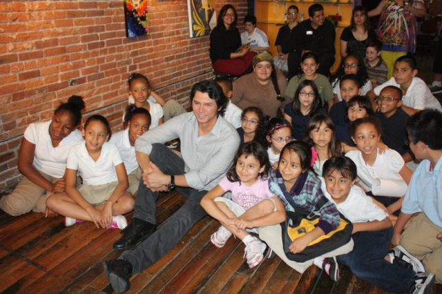 Lou Diamond Phillips visits with the children from the After School Program at the Mattie Rhodes Art Center.