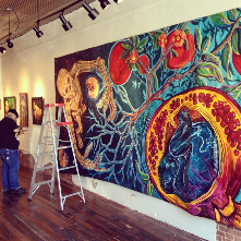 Gerardo Quetzatl Garcia from San Antonio, TX preparing for his solo exhibition at the Mattie Rhodes Gallery.