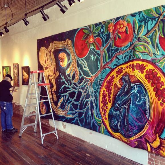 Gerardo Quetzatl Garcia from San Antonio, TX preparing for his solo exhibition at the Mattie Rhodes Gallery.