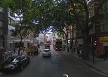 Charing Cross Rd, London. One-way w/plenty of res/comm/etc lining it - heavy traffic, but calm due to skinny lanes.