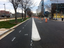 "http://streetsblog.n<wbr/><span class=""wbr""></span>et/2014/04/15/dc-ins<wbr/><span class=""wbr""></span>pires-bike-lane-envy<wbr/><span class=""wbr""></span>-with-curb-protected<wbr/><span class=""wbr""></span>-cycling/<br/>Way better than those poles"