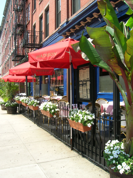 A cafe or other eatery with outdoor seating somewhere along Main Street.