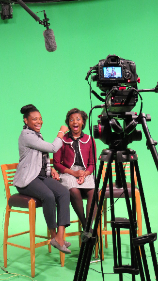 How cool is this? Two students from Jackson-Olin's Academy of Health Sciences ham it up while on the set of an upcoming marketing campaign.