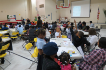 Community Math Night: A group of parents, students, and teachers at Glen Iris Elementary
