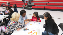 Community Math Night: A Greater Birmingham Math Partnership (GBMP) presenter, a Glen Iris teacher, student and her mother