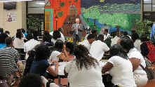 Ed Executive Director Mike Froning addresses students at Woodlawn Magnet High School, encouraging them to attend College 101.
