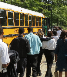 Students from the Woodlawn Academy of Business and Finance get back on the bus after their Initiation Ceremony at the Botanical Gardens.