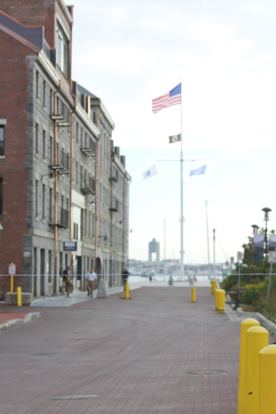 This photo was made on Long Wharf. A thread has been strung to show the moderate level of expected sea level rise.