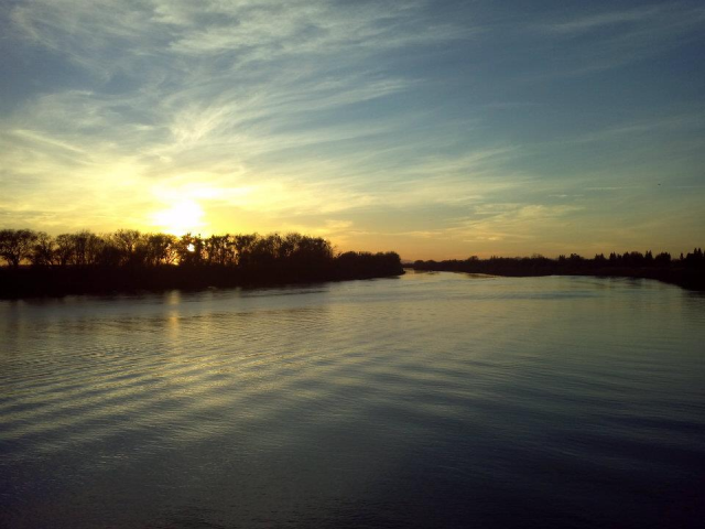 Sunset on the river. View is from the Freeport Water Intake Facility, looking up river. Accessible from Garcia Bend Park bike path.