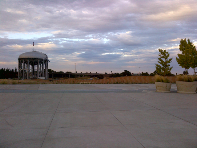 Behind the water tower, on the newly built water facility.