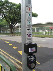 A button for people who want to cross the road and a sensor for elderly people to tap their ez-link cards for extra time.