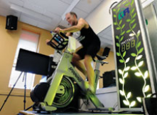 Stationary bike in gym converts wheel movement into energy.