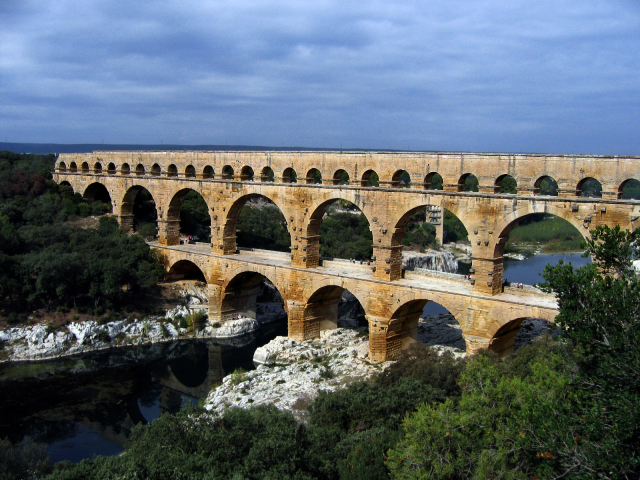 Roman Aqueducts - brought water from distant sources into their cities and towns, supplying public baths, latrine, etc.