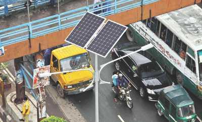 in Dhaka, Using solar panel for charging street light.