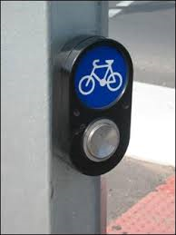 While this is not in my city, I find them very useful in areas I've visited. It allows the signal light to change for cyclists.