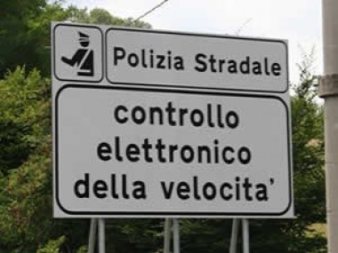 """Electronic speed control"". A simple road sign sometimes works more than a sensor... to make the drivers slow down."
