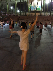 Shenzhen, China. Although people have busy lives during day time, they enjoyed the dance together in front of all tall buildings