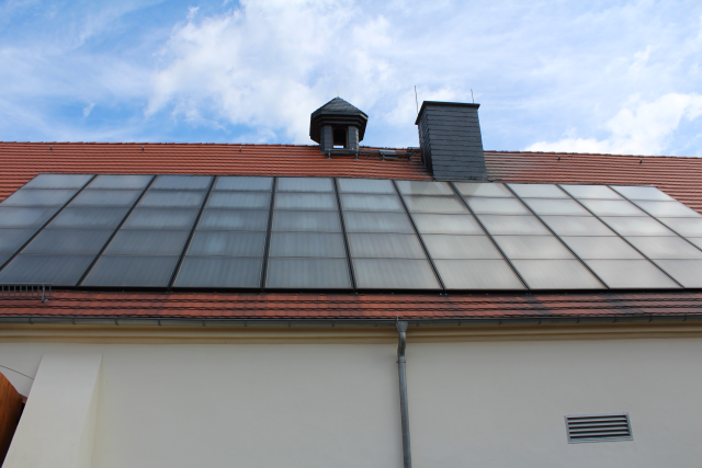 Solar panels on top of biomass plant in Gebelzig, Germany. Sometimes smart cities might be in smart villages too.