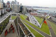 Olympic Sculpture Park in Seattle shows connectivity for pedestrians and vehicles & green space & water coinciding with the city