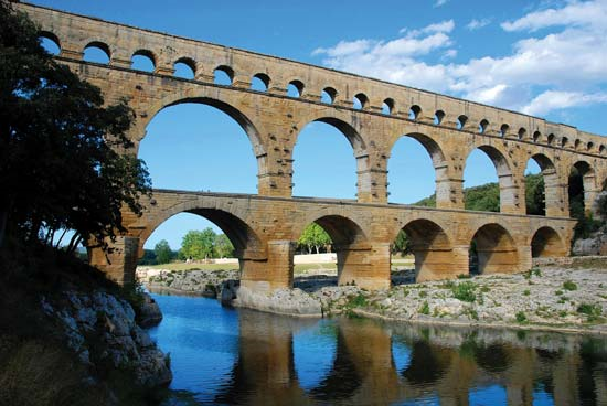 Aqueducts helped supply fresh, clean drinking and bathing water to support large cities in the Roman Empire.