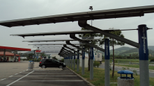 This is a parking lot on the way to Rome that uses solar panels to generate electricity and reduce the heat island effect on the land base.
