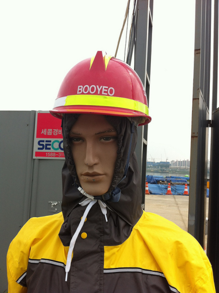Automated construction warnings: Seoul, Korea. This robot/automaton/mannequin guides pedestrians away from dangerous construction sites.