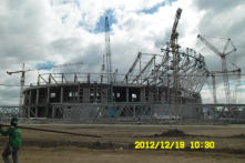 Philippine Arena.  Located in Bulacan (Greater Manila Area), it'll be the world's largest domed arena (36,000 sq.m.) when finished in 2014.