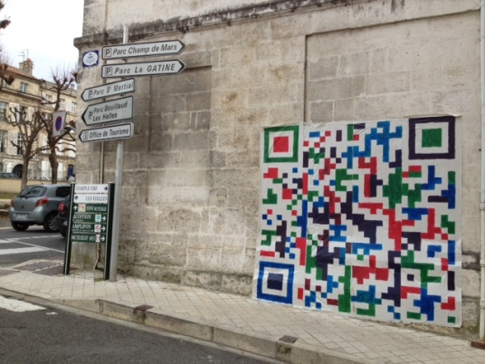 A nice big QR code in a sidewall of Angoulême's Theatre (France) that leads to a film.