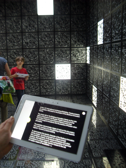 At the Venice Biennale of 2012 I saw this amazing expo using a tablet a QR codes to show the proposed urban plan of a tech-city on Russia.