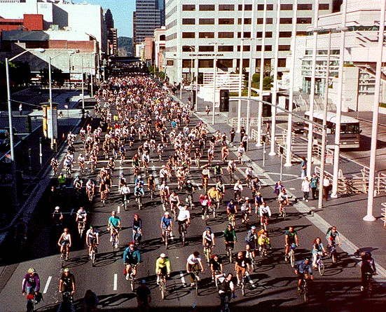 Critical Mass happens every last Friday of the month is San Francisco. Sometimes thousands of people get together to ride their bikes