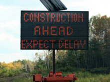 I need to say that I am not happy when I see one of this signs, but it is a big help on large, jammed roads.
