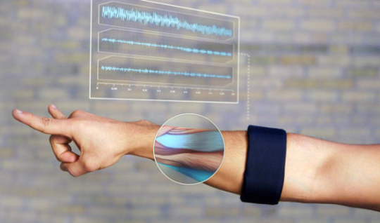 Myo is an armband full of sensors that are able to pick up on the electrical activity in your muscles. Has bluetooth,works with windows, mac