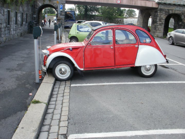 I took this photo an year ago in Oslo, Norway. As you can see, there's an old style Citroen 2CV recharging electricity as an EV.