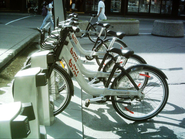 """bicycle + taxi = BIXI"" (a portmanteau created by Michel Gourdeau) is the name for the Public Bike System for the City of Montreal, Canada."