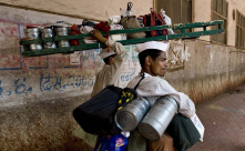 A dabbawala, is a person in India,  who is employed in a unique service industry...<br/>Chk wikipedia for reference