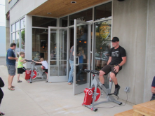 Riding the bicycle outside of this brew pub in Portland Oregon provides the energy for the building.  Customers also get a discount.