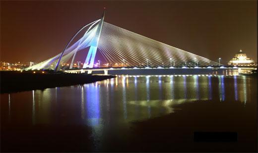 One of the many beautifully illuminated bridges in Putrajaya, WP Kuala Lumpur, Malaysia