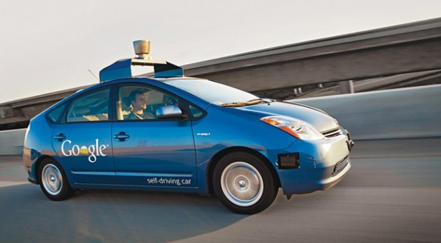 Google's self-driving car. See these running around the streets/highways in Silicon Valley pretty regularly these days.