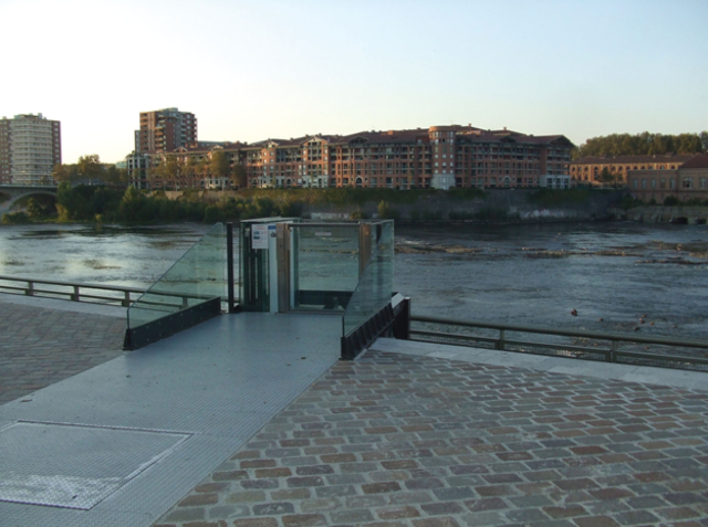 This is an elevator in Toulouse, France that gives access to a walkway next to the river.
