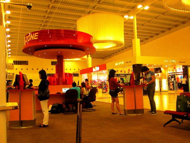 Singapore's Changi Airport Budget Terminal waiting area. Computers and internet access are provided for passengers waiting for their flight.