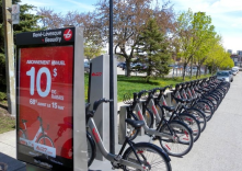 Bixi! It is a bicycle sharing system. The stations are powered by solar panels. <br/>Bixi began its work here in Montreal for the first time.