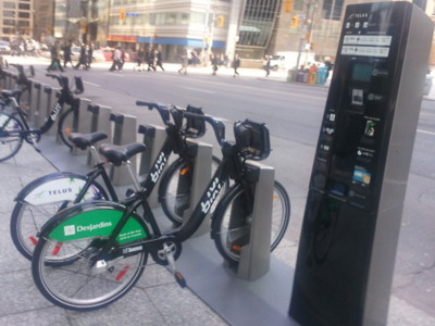 This photo is taken in Toronto, where they have used technology to rent bikes and be able to use them as a transportation mode.