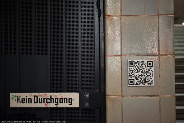 "Berlin, SWEEZA:QRcodes that show ""Smile!You are being filmed!"",when captured by scanners surveillance cameras."
