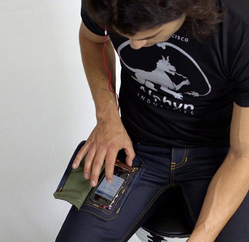 http://www.ohgizmo.com/2012/06/25/jeans-solve-first-world-problem-with-see-through-smartphone-pocket/