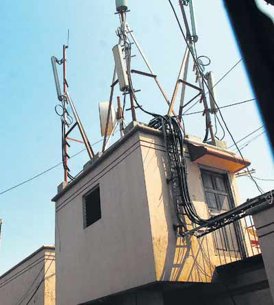 Mobile tower in the roof of a building